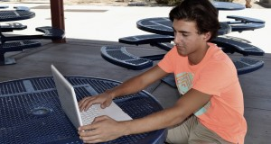 Dallin with a laptop - photo by Lluvia Moreno