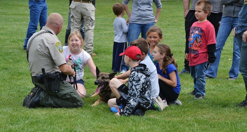 K9 Arthur enjoys pets from the kids after working hard - photo by Gina Clugston