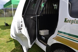 Mechanism that opens rear door of patrol vehicle to let dog out - photo by Gina Clugston