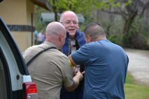 Sheriff Jay Varney gets suited up to get bit - photo by Gina Clugston