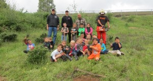 Mike Nolen, Richard Perez, Elodio Oronia, Rudy Yrigollen with North Fork kindergartners planting trees on Earth Day - photo courtesy Mike Nolen