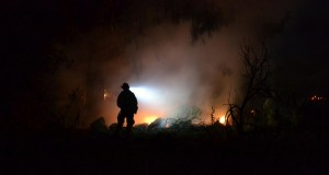 Firefighter on Revis Circle Fire - photo by Gina Clugston