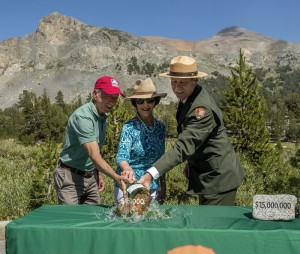 "July 28,  2015--Tioga Road Rededication Ceremony-- A ceremony was held in Yosemite National Park to rededicate the Tioga Road. The highest road crossing of the Sierra at 9,945 feet, was originally dedicated on July 28, 1915. Pictured here (L to R) are Jerry Edelbrock, VP, Yosemite Conservancy, Laura Bush, Former First Lady and Co-Chair National Park Service Centennial, and Yosemite National Park Superintendent Don Neubacher. A ""christening bottle"" was broken over a ceremonial rock to reenact the original dedication, exactly 100 years ago. Photo by Al Golub/Yosemite Conservancy"