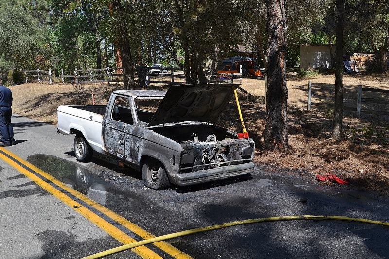 Burned out Ford pickup on Road 226