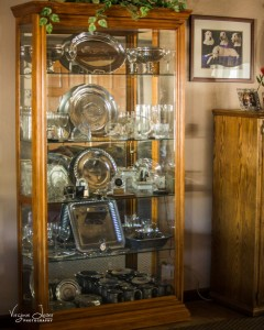 Gail Hawksworth cabinet filled with trophies to commemorate competition placements by her top-notch Irish Wolfhounds - photo by Virginia Lazar 2015