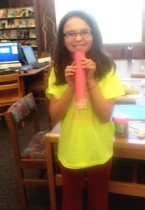 Stevi Valenzuela posing with her handcrafted kazoo