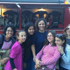 Rachel Rivera, Station 11 Firefighter, with campers at Siderman Family Camp