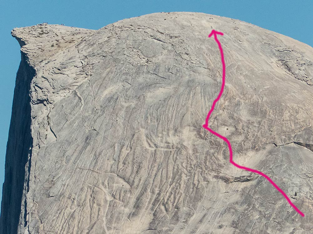 Two tiny climbers on the Snake Dike Route on Half Dome, just above the arrow - photo by Keith Sauer