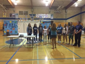 YHS Rally Sept 25 2015 Chamber singers perform National Anthem led by Jamie Helwig - photo by Clara Briley