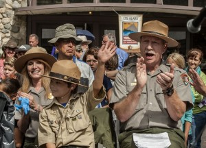"October 1, 2015: Gabriel Lavan-Ying, 10 of Gainesville, Florida, became an Honorary Yosemite National Park Ranger in June 2014. Lavan-Ying, better known as ""Ranger Gabriel"" served as the Honorary Chairman of the park's 125th Anniversary. Ranger Gabriel is seated with Yosemite National Park Superintendent Don Neubacher during a ceremony to commemorate the landmark Anniversary conducted in Yosemite Valley today. (Al Golub/NPS)"