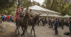 October 1, 2015: Yosemite National Park's Mounted Patrol Park Rangers Julie Byerly and Justin Fey retire the colors at the conclusion of Yosemite National Park's 125th Anniversary celebration. Approximately 1500 people, including 400 students from the Yosemite area and the Central Valley, attended the ceremony today in Yosemite Valley. (Al Golub/NPS)