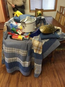 Johnson burglary - possessions on quilt ready for easy removal - Jan 18 2016 - courtesy Tammy Johnson
