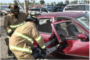 """CAL FIRE Engineer Daniel Valenzuela, former Madera County PCF, volunteering his off-duty time as PCF academy instructor, is shown supervising a PCF recruit in the operations of the """"Jaws of Life"""""""