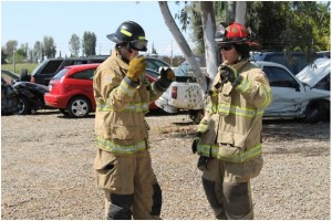 Fire Captain Vance Killion briefing PCF recruit Morgan Mayer, team leader, on techniques of vehicle stabilization drill - photo by Bill Ritchey