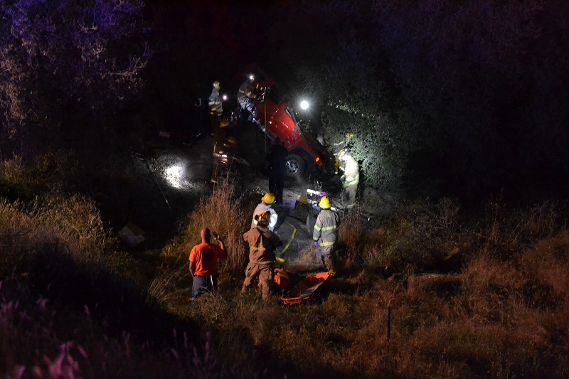 Firefighters work to extract crash victim at Highway 41 wreck - photo by Gina Clugston