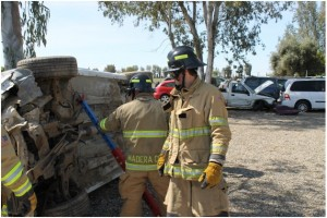 PCF Morgan Mayer, as team leader, directing team members in vehicle stabilization using struts - photo by Bill Ritchey