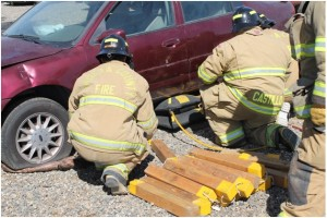 PCF recruits utilizing compressed air rescue bags and cribbing to raise vehicle off trapped victim - photo by Bill Ritchey