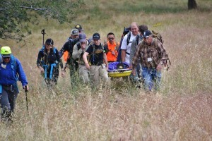Team Delta carries injured subject on litter - photo by Gina Clugston