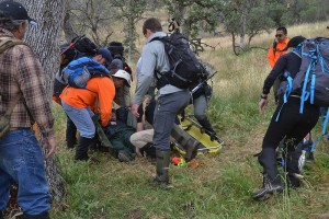 Team Delta lifting injured subject onto litter - photo by Gina Clugston