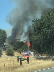 Coarsegold fire June 27 hwy 41 photo shows patriotic decorations and flag with fire by Sharon Regert