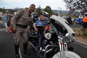 Kids learn about CHP motorcycle at National Night Out