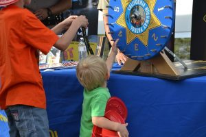 Kids spin the wheel at National Night Out