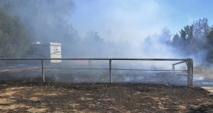 Kowana Fire burns near trailer - photo by Gina Clugston