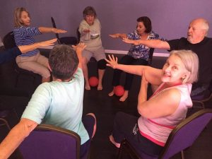 dave-caris-chair-yoga-reaching-in-with-cindy-smiling-sept-2016-kellie-flanagan