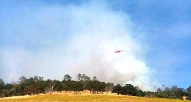 Helicopter dropping water on Gaines fire.