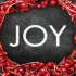 Picture of a wreath with the word JOY in the center