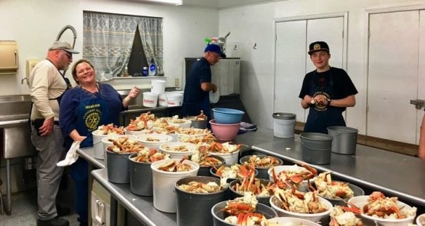 Picture of kitchen workers at the crab feed.