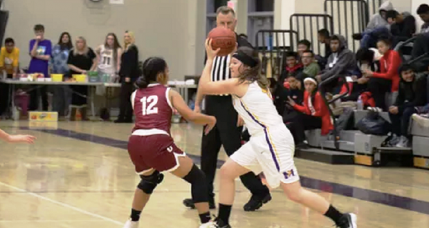 Picture of Junior Makayla Lundgreen taking the ball down the court during the recent Orosi game.