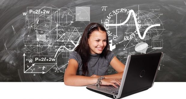 Picture of young woman typing on laptop.