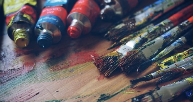 Image of wet paint brushes on an easel.