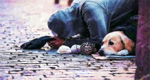 Image of a homeless person with their dog.