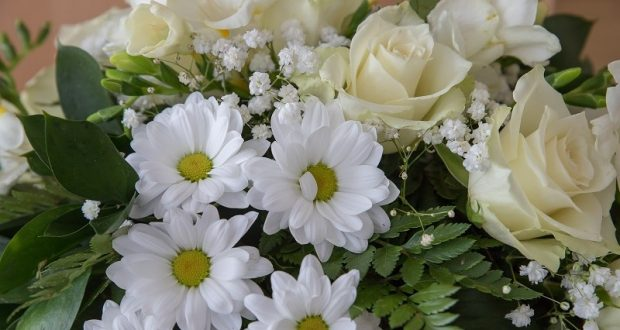 Image of white funeral flowers.