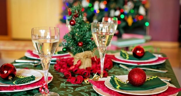 Image of a table set for Christmas dinner.