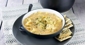 Image of a bowl of tomato tortellini soup.