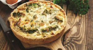 Image of a bacon, cheese, and broccoli quiche.