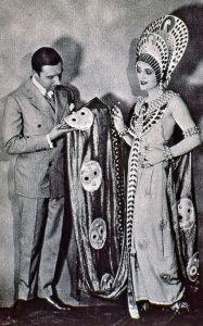 Image of Erté working on a movie wardrobe - full-size image.