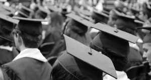 Black and white image of a graduation ceremony.