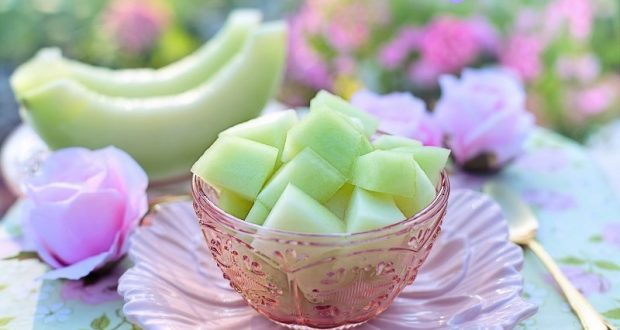Image of a bowl of honey dew melons.