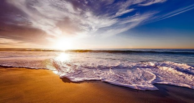 Image of a beach at sunset.