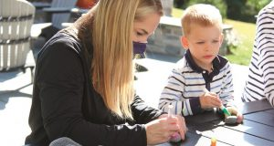 Image of a mother and child drawing a picture.