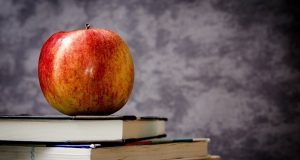 Image of an apple on a stack of books.
