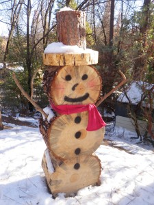 Snowman carved from dead tree rounds in Cascadel Woods - photo by Joanne Freemire
