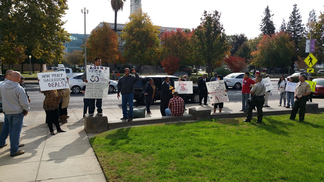 Tex McDonald supporters protest outside court 11-12-14