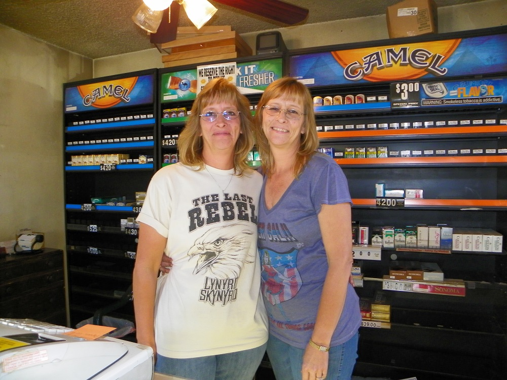 Julie Hoetker and Jean Field on the last day of business for The Cigarette Shack in Coarsegold