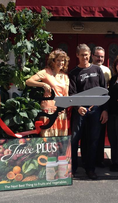 Jannai and John Pero and Dan Rule at ribbon cutting - photo courtesy Jannai Pero
