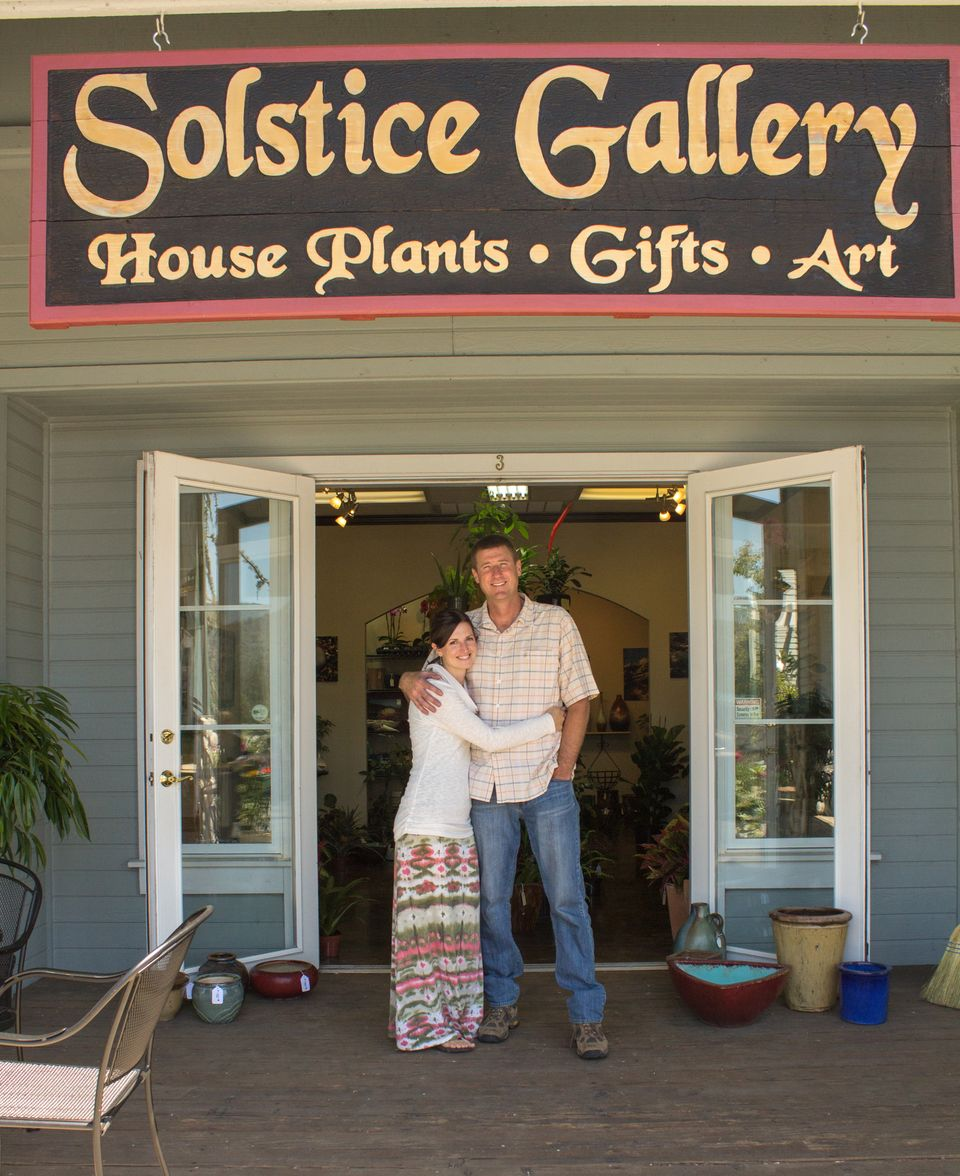 Solstice Gallery and Solstice Salon owners Amy and Clay Duke outside in front of new sign - Photo by Virginia Lazar